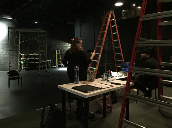 "Rehearsal Day 1... A black box in disarray, and director, Kim Weild in conference with lighting designer, John ""Juba"" Alexander."